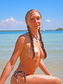 Busty blonde babe Victoria Nelson swimming topless in the sea