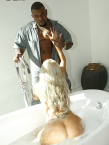 Big boobed blonde Nina Elle bangs a black stud while her cuckold watches