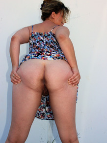 Naughty housewife June Larue goes for a walk in public with butt plug in ass
