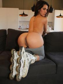 Spanish girl Samia Duarte slides spandex pants over big ass in roller blades