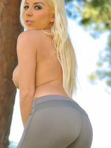 Acrobatic blonde Alex Adams takes her sexy tight yoga pants off outdoors