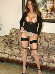 Latian wife gives her husband a blowjob while modelling backseam stockings