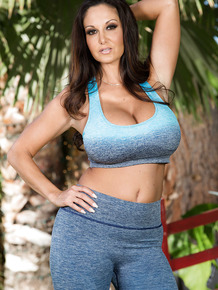 Curvy pornstar Ava Addams reveals knockers while removing yoga clothes in yard
