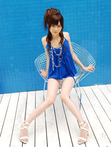 Young looking Japanese girl Anna Watanabe models non nude in shorts