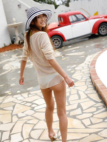 Japanese solo girl with red hair Yu Saotome wanders around in bikini and a hat