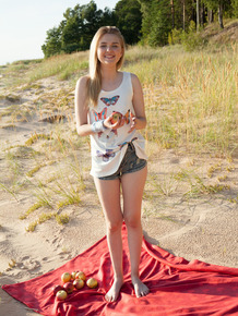Smiley blonde Nimfa spreading on a blanket outdoors to show off her bald taco