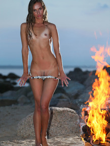 Cutie Patsy A takes her tiny bikini off and shows her sandy tanned body
