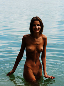 Hot skinny Sandra Lauver playing naked in the water and rolling in the sand