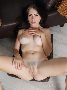Young brunette Niemira displays her pussy pussy while posing naked