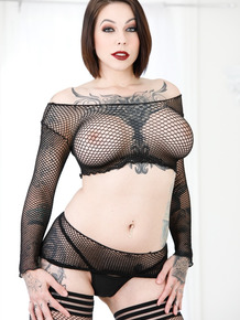Inked model Harlow Harrison teases in sexy fishnet outfit and black boots