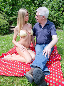 Young blonde girl brings an old man back to life by fucking him on a blanket