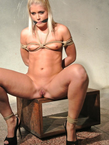 Naked blonde sub Sandy tied to crate for vibrator torture with tits rope bound