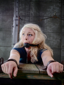 Blonde schoolgirl Ella Nova is rendered helpless in a dungeon