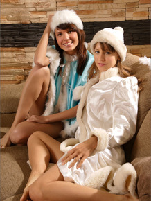 Two horny little snow bunnies kissing and fondling each other before the fire