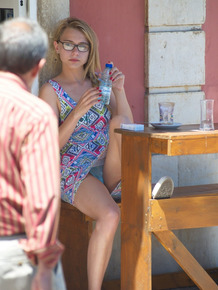 Beautiful blonde Chloe goes topless to make fresh OJ on a sunny morning