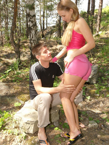 Young blonde and her man friend fuck on blanket in the forest
