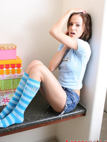 College girl Addison St James shows perky tits and bare ass in knee socks