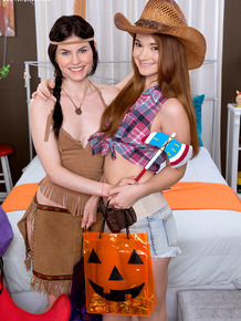 Young lesbians Ava Sparxxx & Heather Night remove Halloween outfits before sex
