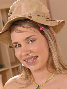 Young girls with braces happily takes both of her lovers semen into her mouth