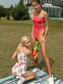 Slim teens Cindy Shine & Kiara Cole share double dildo after a water fight
