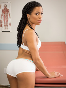 Ebony Kira Noir loves to pose for the camera while wearing white sneakers