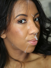 Brunette female Sophia Fiore sucks off a cock via a gas station gloryhole