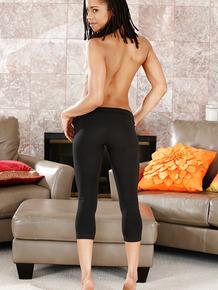 Petite ebony ten Kira Noir posing solo in yoga pants and sports bra