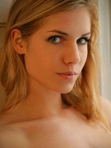 Blonde beauty Iveta B models totally naked with a carefree attitude