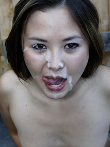 Young Asian girl licks cum off her face after having sex in a car
