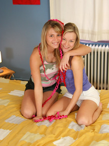 Cute teen girls go lesbian after trying on soccer outfits on a bed