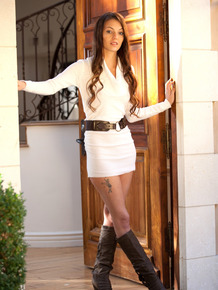 Gorgeous young brunette Alexis Venton in mini dress & boots kissing boyfriend