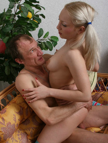 Young blonde girl in striped OTKs and pigtails fucks her old lover